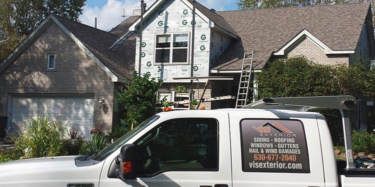House after cost effective shingle roof installation