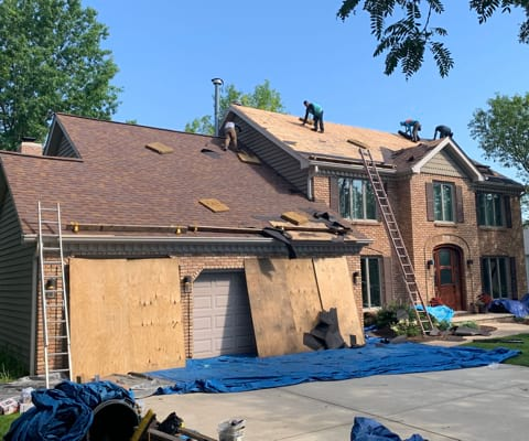 Shingle roofing replacement after hail damage