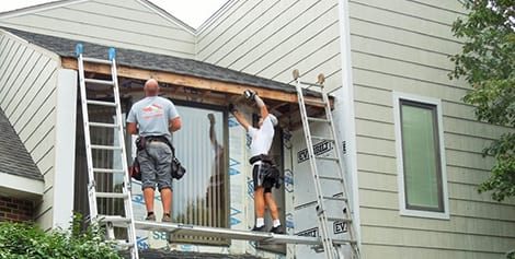 Siding and roofing contractors after hail damage