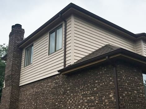 Complete exterior remodeling project photo after siding and roofing services in Downers Grove