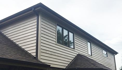 Durable cedar siding and shingle roofing project photo in Downers Grove