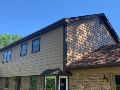 Cedar siding installation and windows replacement in Oak Brook project photo