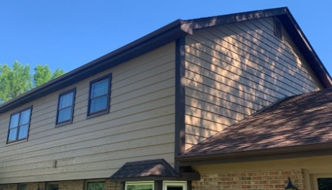 Cedar siding installation and windows replacement in Oak Brook project photo 1