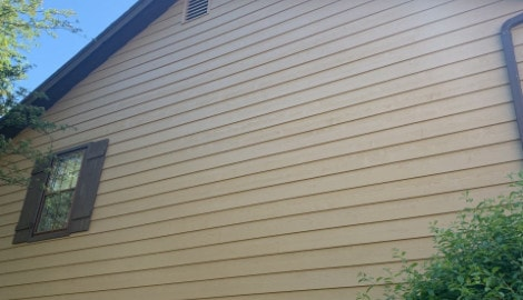 Cedar siding installation and windows replacement in Oak Brook project photo 3
