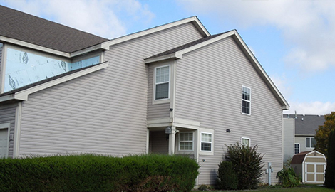 Exterior remodel project photo after shingle roofing and vinyl siding replacement in Mundelein