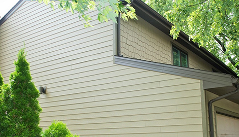 Northbrook house exterior remediation with durable james hardie lap siding