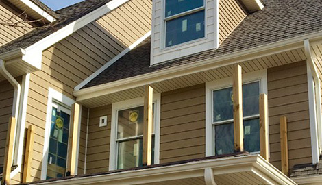Family house photo after LP Diamond Kote siding and gutters installation in Naperville