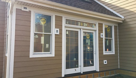 LP Diamond Kote siding replacement and gutters installation in Naperville