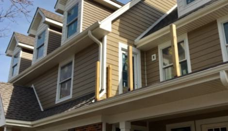 LP Diamond Kote siding installation and gutters replacement in Naperville project photo 1