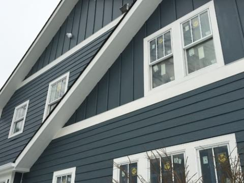 LP SmartSide wood siding Installation and gutters replacement in Glen Ellyn project photo 1