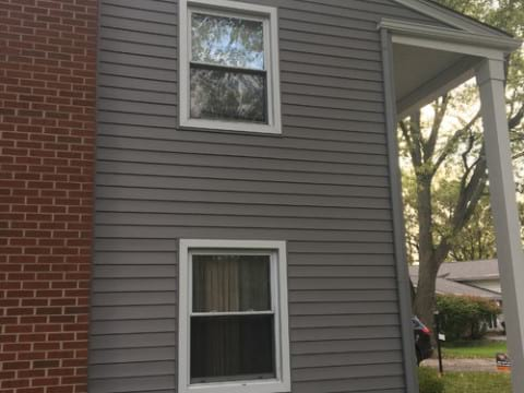 LP SmartSide wood siding Installation and gutters replacement in Downers Grove project photo 4