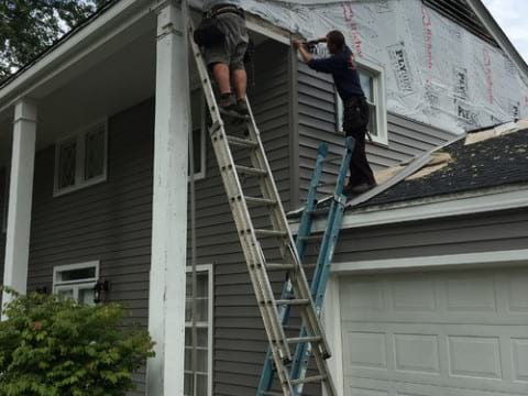 LP SmartSide wood siding Installation and gutters replacement in Downers Grove project photo 6