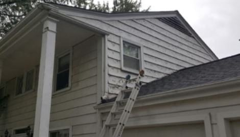 LP SmartSide wood siding Installation and gutters replacement in Downers Grove project photo 7