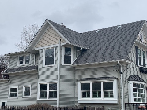 Royal Estate siding installation and shingle roof replacement in Arlington Heights project photo