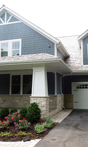 Charming exterior transformation project photo after fiber cement installation and roof replacement in Northbrook