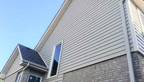 Beautiful house exterior project photo after vinyl siding installation in Darien