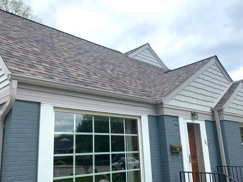 Vinyl siding installation and shingle roof replacement after hail damage in Clarendon Hills project photo