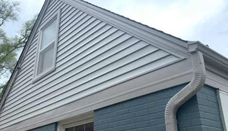 Vinyl siding installation and shingle roof replacement after hail damage in Clarendon Hills project photo 2