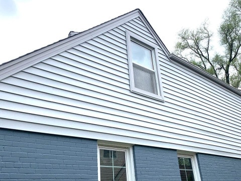 Vinyl siding installation and shingle roof replacement after hail damage in Clarendon Hills project photo 3
