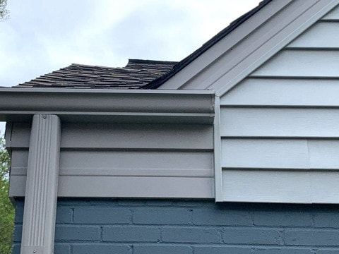 Vinyl siding installation and shingle roof replacement after hail damage in Clarendon Hills project photo 4