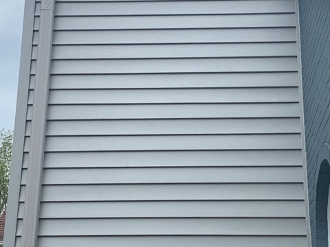 Vinyl siding installation and shingle roof replacement after hail damage in Clarendon Hills project photo 6