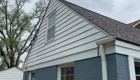 Vinyl siding installation and shingle roof replacement after hail damage in Clarendon Hills project photo 8