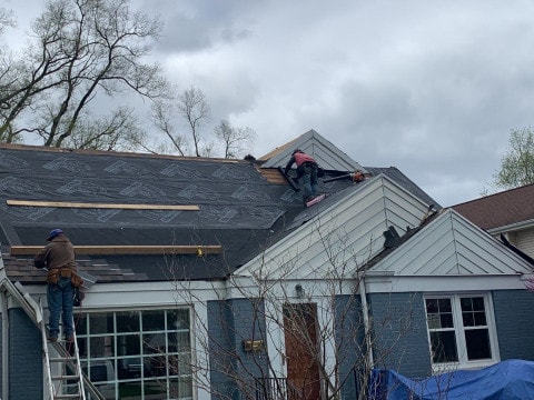 Vinyl siding installation and shingle roof replacement after hail damage in Clarendon Hills project photo 9
