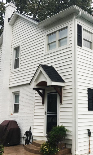 "White prodigy double 6"" vinyl siding and roofing project photo in Lombard"