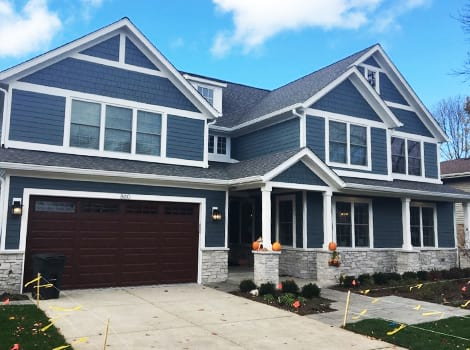 Jame Hardie siding and windows trim replacement project in Northbrook