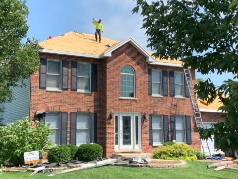 Vinyl siding, roofing & gutters replacement after hail damage in Naperville project photo 3