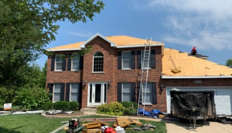 Vinyl siding, roofing & gutters replacement after hail damage in Naperville project photo 4