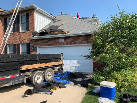 Vinyl siding, roofing & gutters replacement after hail damage in Naperville project photo 5