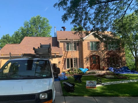 Shingle roofing replacement after hail damage in Naperville project photo 1