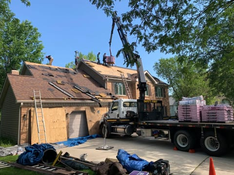 Shingle roofing replacement after hail damage in Naperville project photo 3