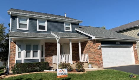 Full exterior remodeling vinyl siding installation shingle roof replacement in Naperville before after project photo 1