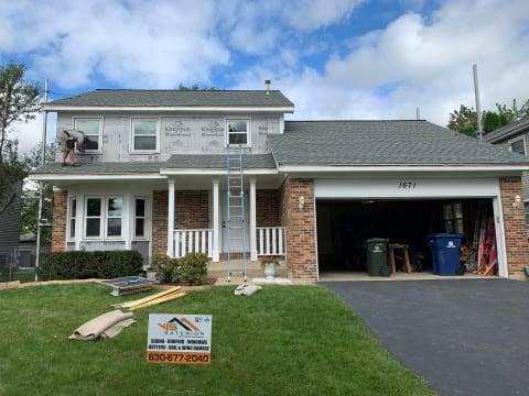 Full exterior remodeling vinyl siding installation shingle roof replacement in Naperville before after project photo 11