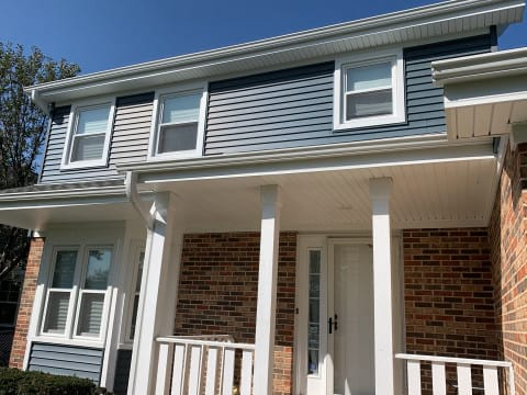 Full exterior remodeling vinyl siding installation shingle roof replacement in Naperville before after project photo 3
