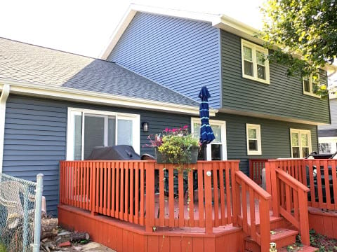 Full exterior remodeling vinyl siding installation shingle roof replacement in Naperville before after project photo 5