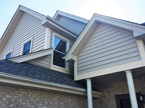 Alside insulated Prodigy vinyl siding installation and roof repair project photo in Darien
