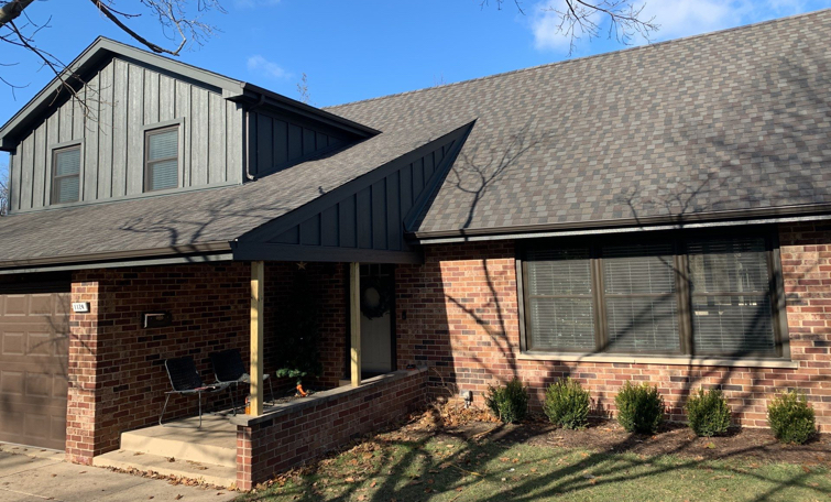 Asphalt shingle roofing and gutters in Oak Brook, IL